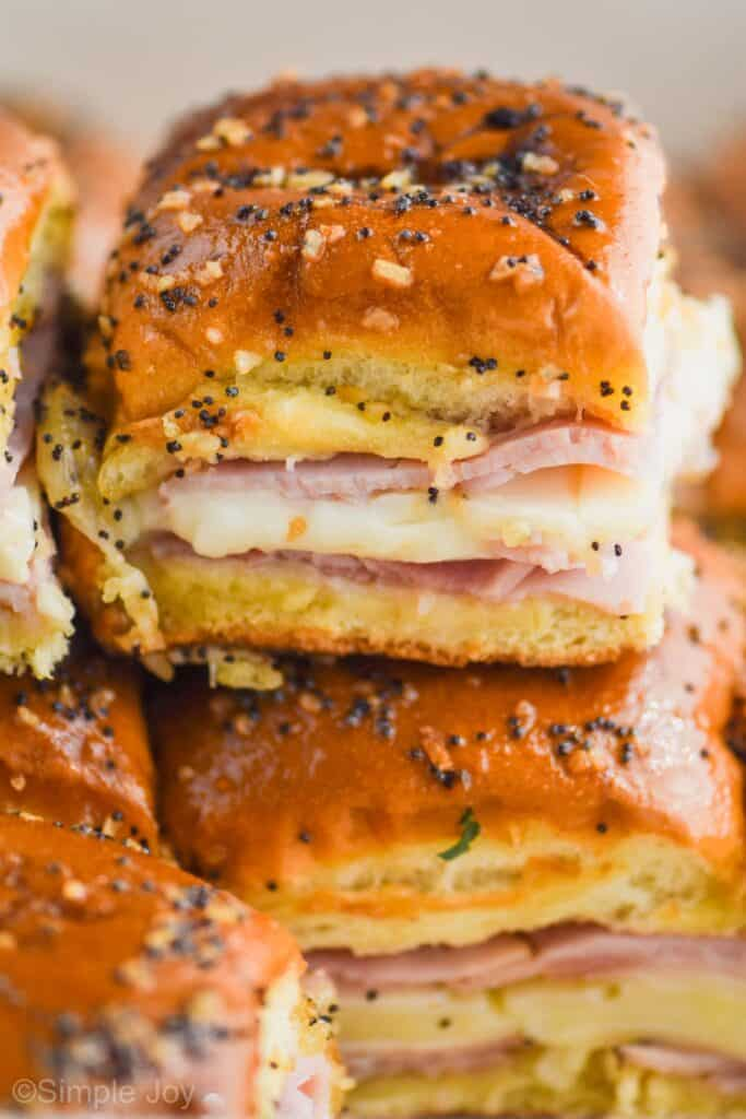 a batch of ham and cheese sliders recipe stacked one on top of the other