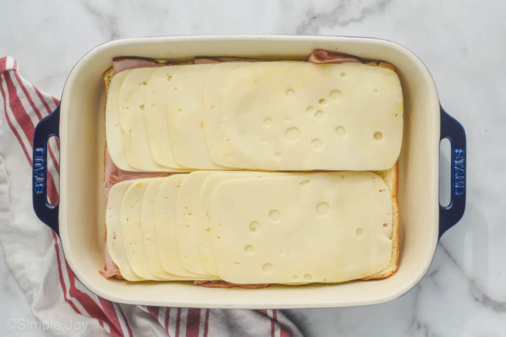 Swiss cheese layered on ham to make ham and cheese sliders