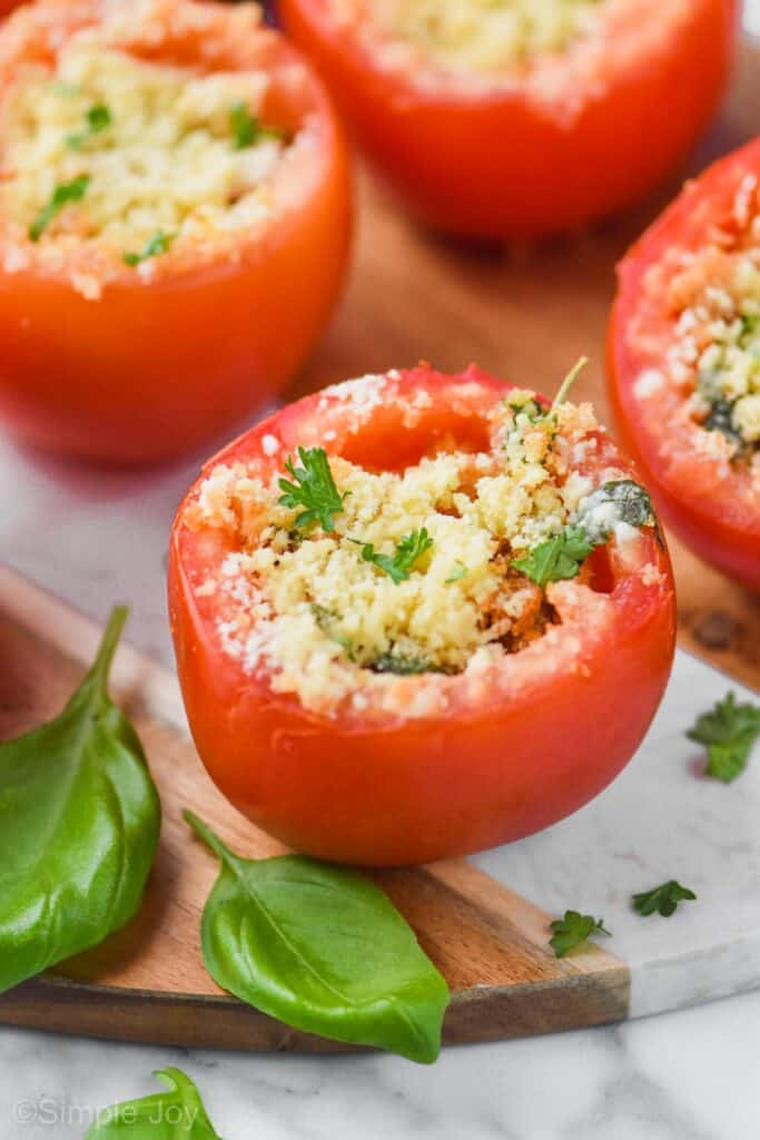 a baked stuffed tomato garnished with fresh parsley