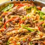 close up of a skillet full of beef lo mein