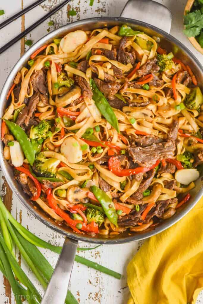 overhead of a skillet full of beef lo mein