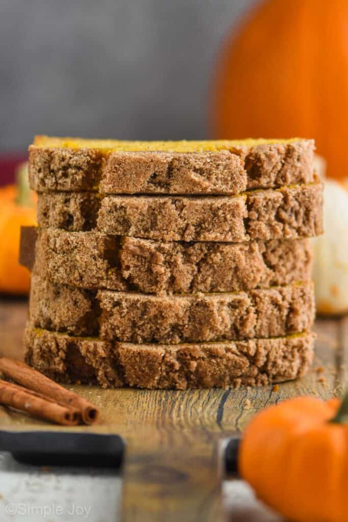 a stack of five pieces of the best pumpkin bread recipe