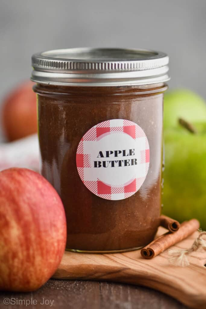 "small mason jar with a label that says ""apple butter"""