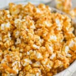 side view of a bowl of caramel corn