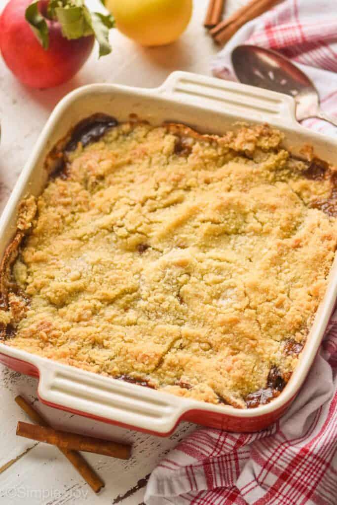 square baking dish holding apple crisp