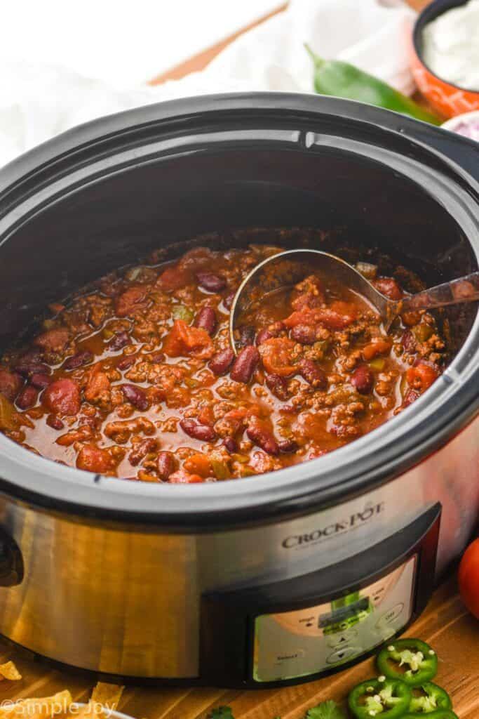 side view of a slow cooker full of easy crockpot chili