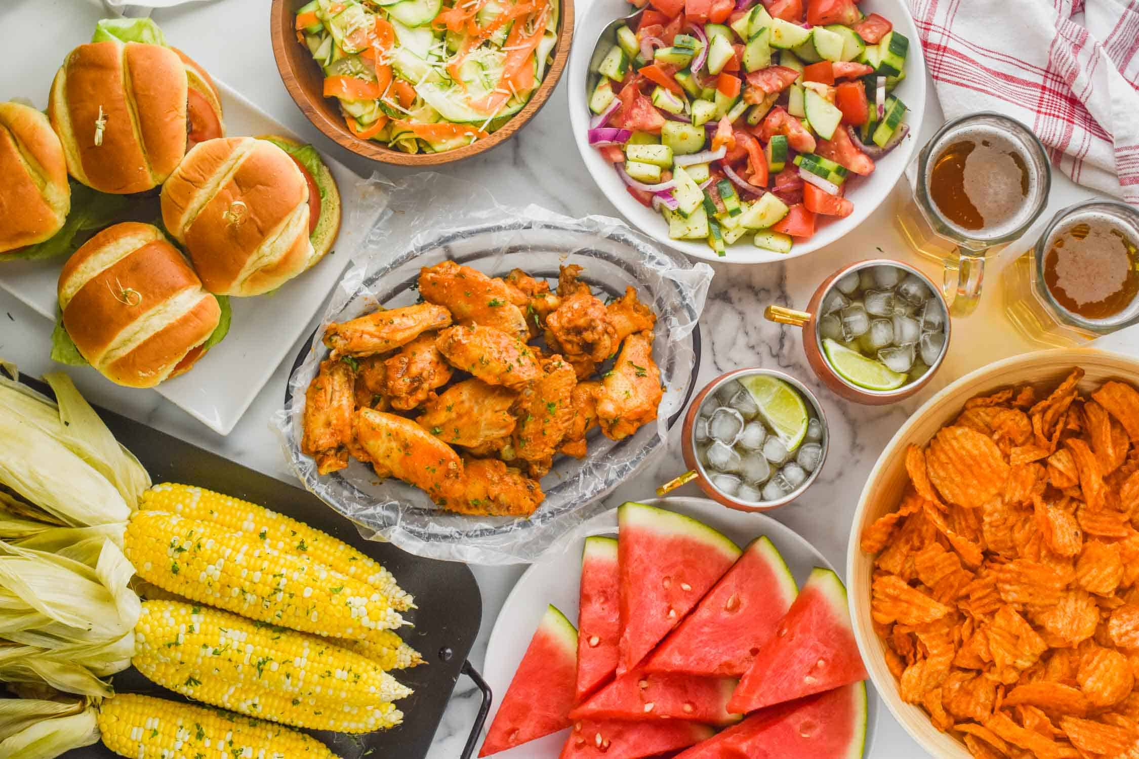 overhead view of table full of summer picnic food