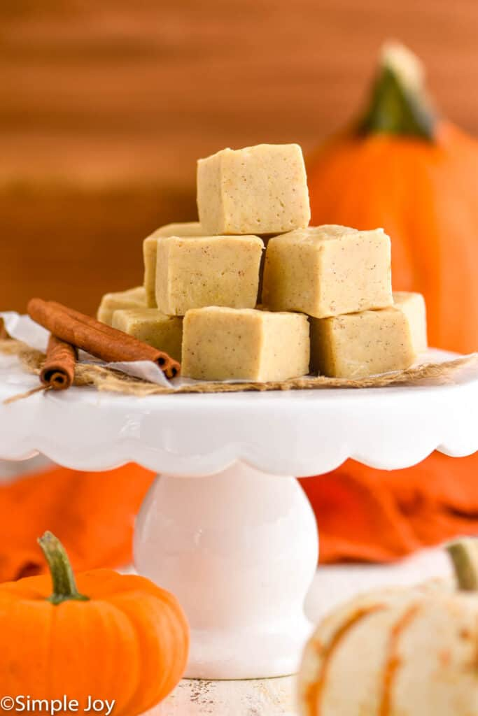 a pile of pumpkin fudge on a cake stand