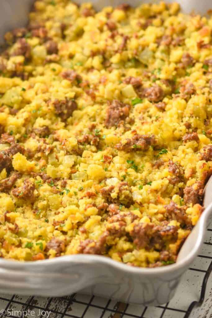 close up of a baking dish full of cornbread sausage stuffing