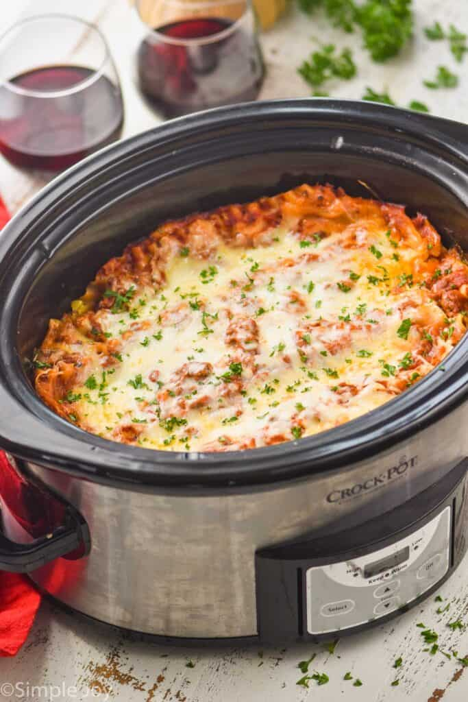side view of a slow cooker full of crockpot lasagna