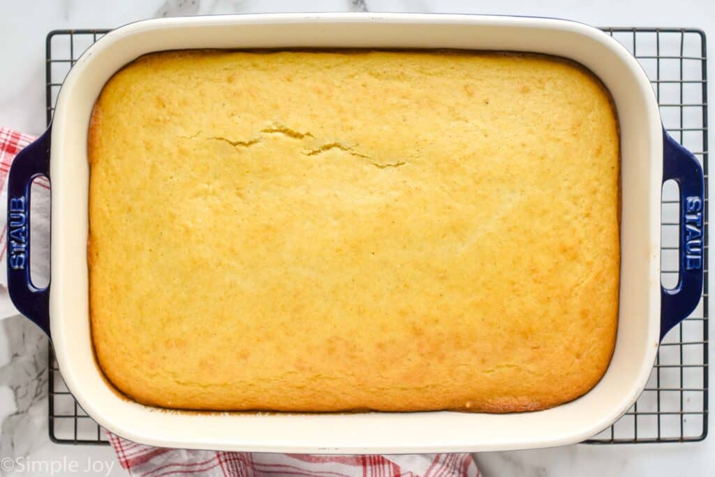 overhead picture of easy cornbread recipe in a baking dish on a cooling wrack