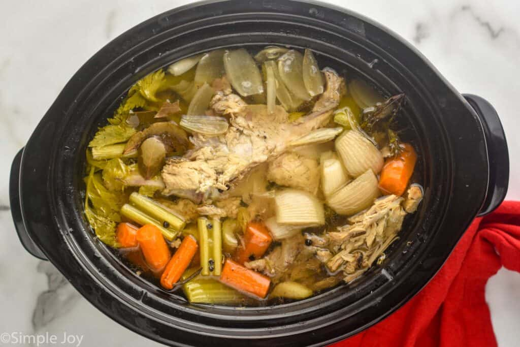 overhead view of a crockpot full of turkey broth
