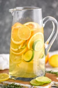 tall pitcher full of sangria with lemons, limes, and oranges