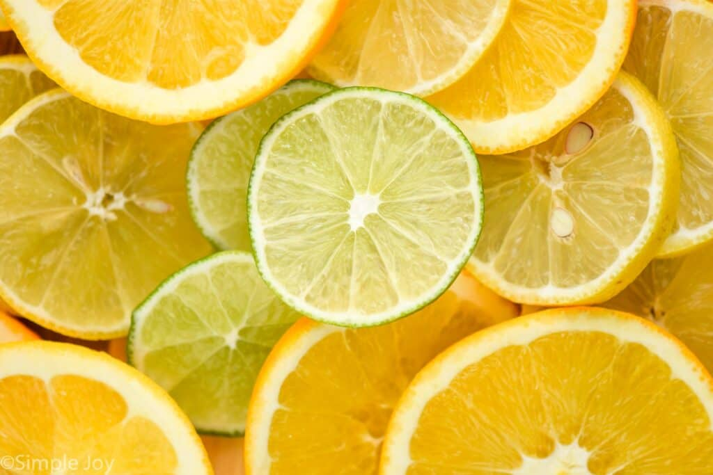 overhead close up photo of slices of lemons, limes, and oranges