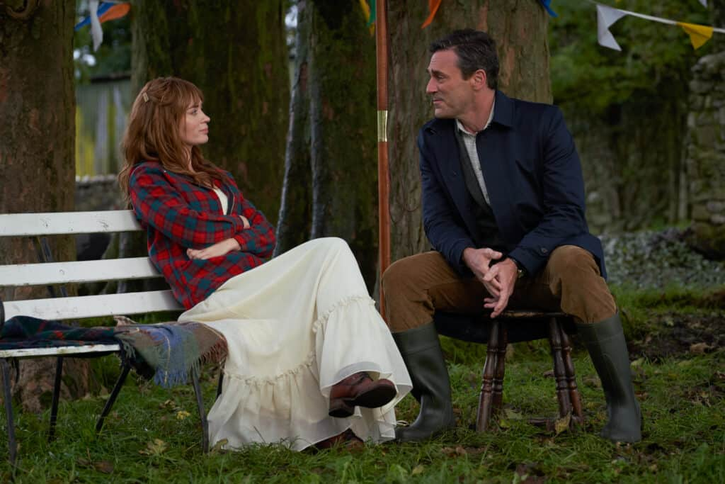 still frame from movie wild mountain thyme featuring Emily blunt and John Hamm sitting outside