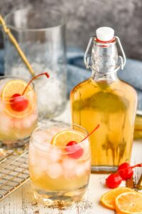 two glasses of amaretto sour with homemade amaretto liqueur
