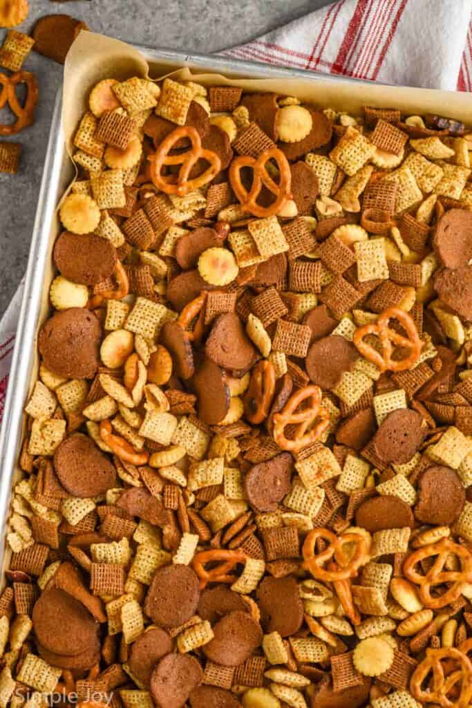 overhead view of a baking sheet of Chex mix recipe you make in the oven