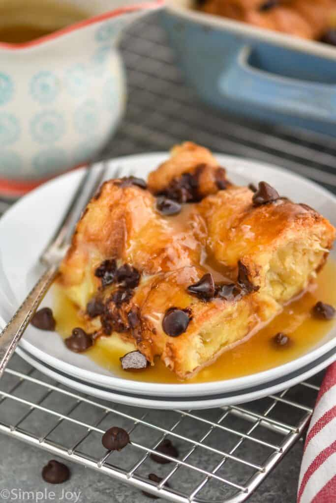a square piece of croissant bread pudding smothered in brown sugar sauce