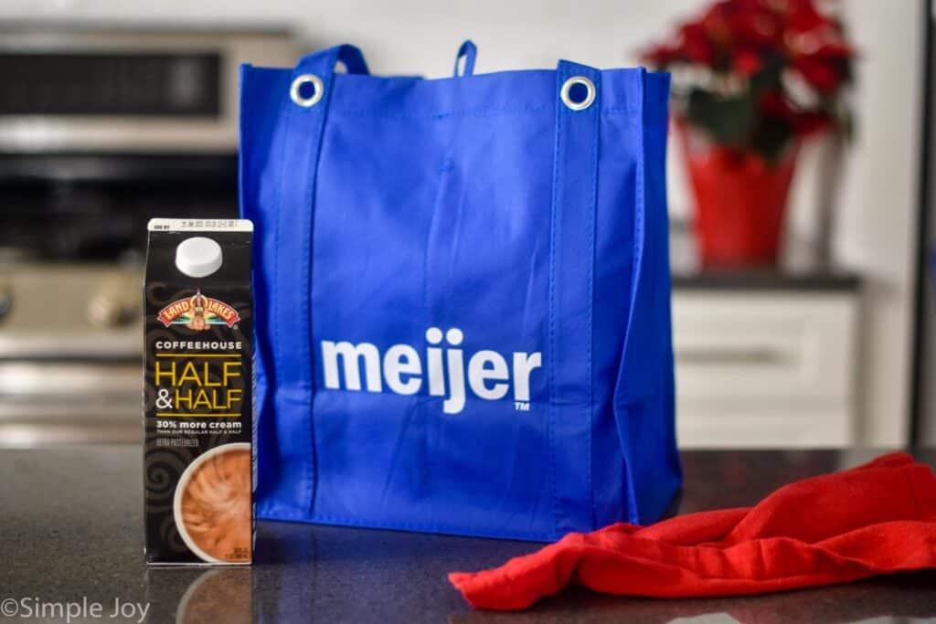 a reusable Meijer bag next to a carton of land o lakes coffee house half and half