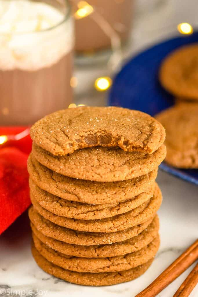 stack of molasses cookies with the top one missing a bite