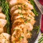 close up of a pork tenderloin recipe cut up and on a serving platter