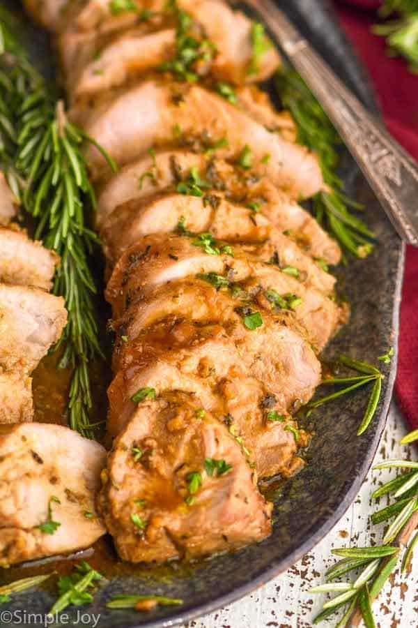 close up of a pork tenderloin recipe cut up and on a serving platter