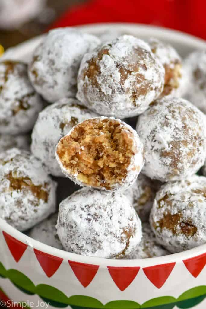 close up of a rum ball that has a bite taken out of it