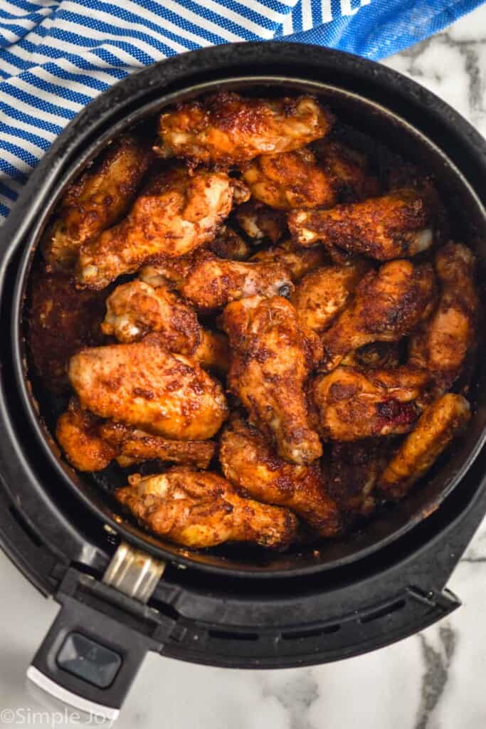 overhead view of chicken wings in air fryer
