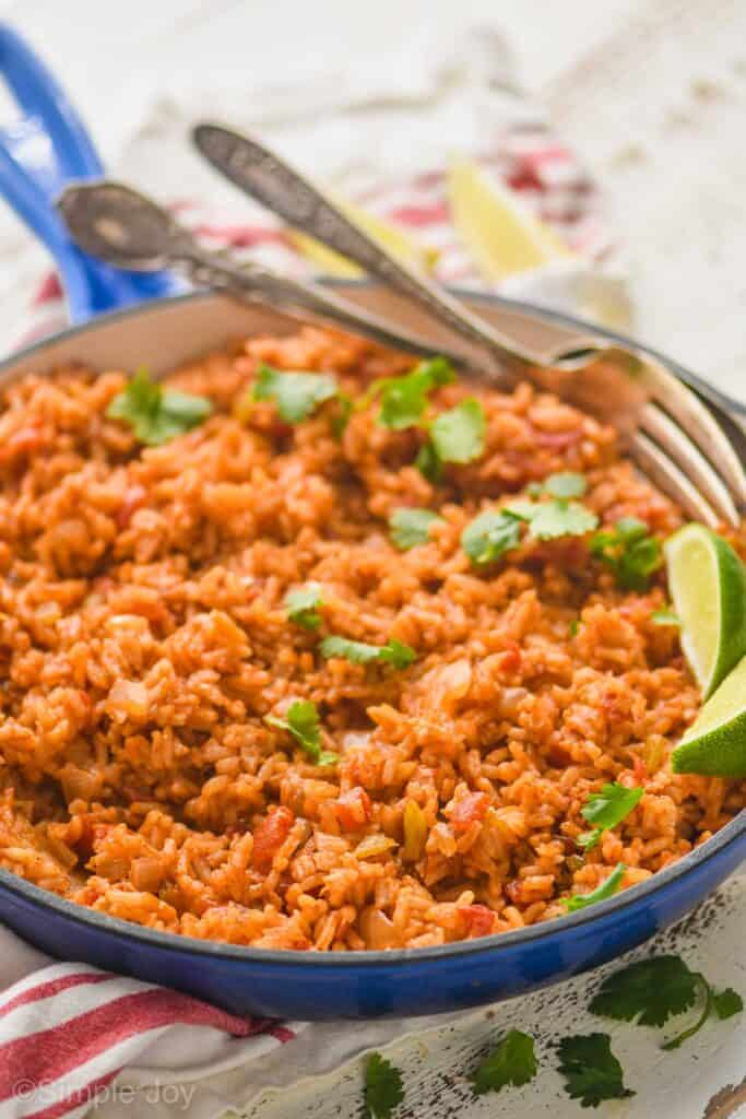 side view of a skillet full of Spanish rice