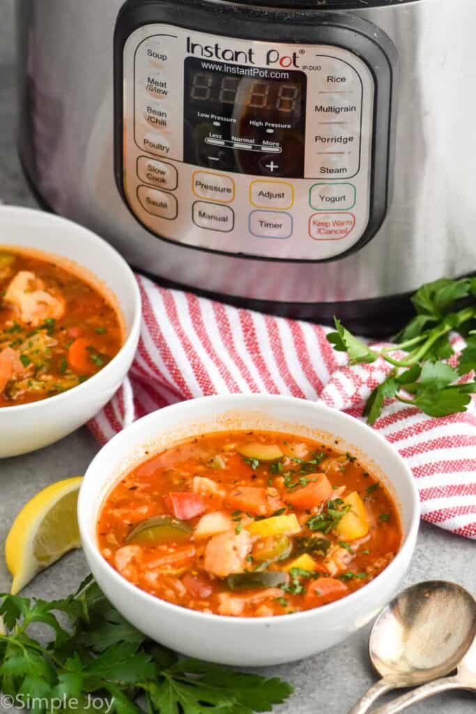 pulled back view of two boys of soup in front of an instant pot