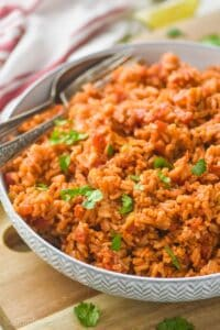 a bowl of Spanish rice garnished with cilantro