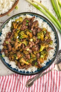 overhead view of a bowl of beef and broccoli made in the instant pot over rice