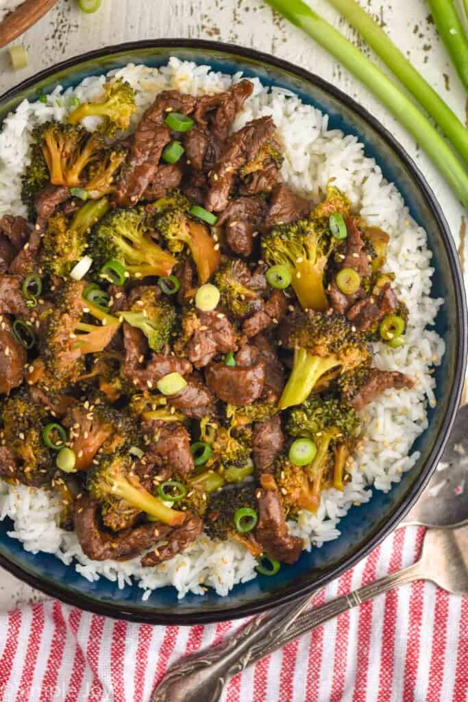 overhead view of a bowl of instant pot beef and broccoli over rice