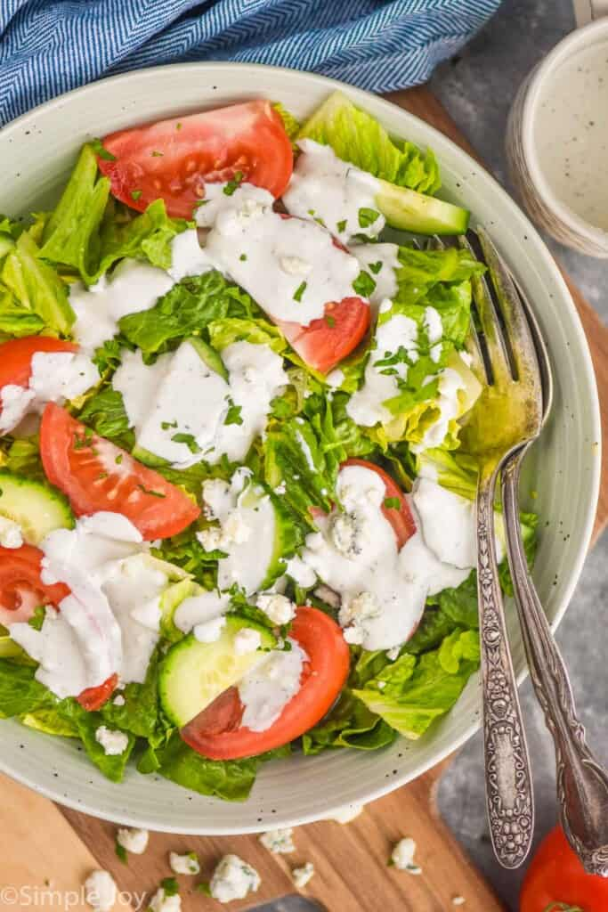 overhead view of a bowl of salad with blue cheese dressing