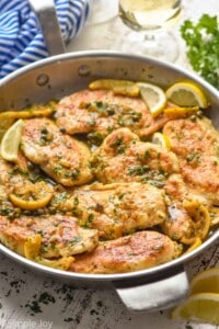 side view of a skillet full of easy chicken piccata