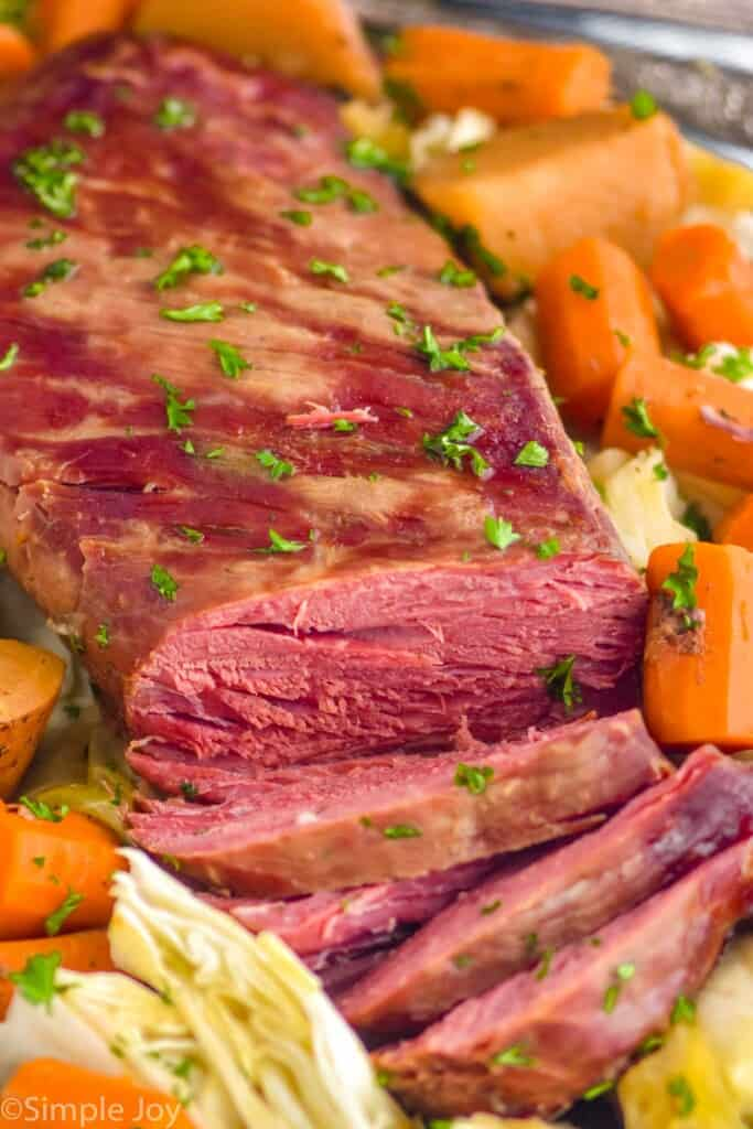 close up of corned beef and cabbage recipe that has been sliced