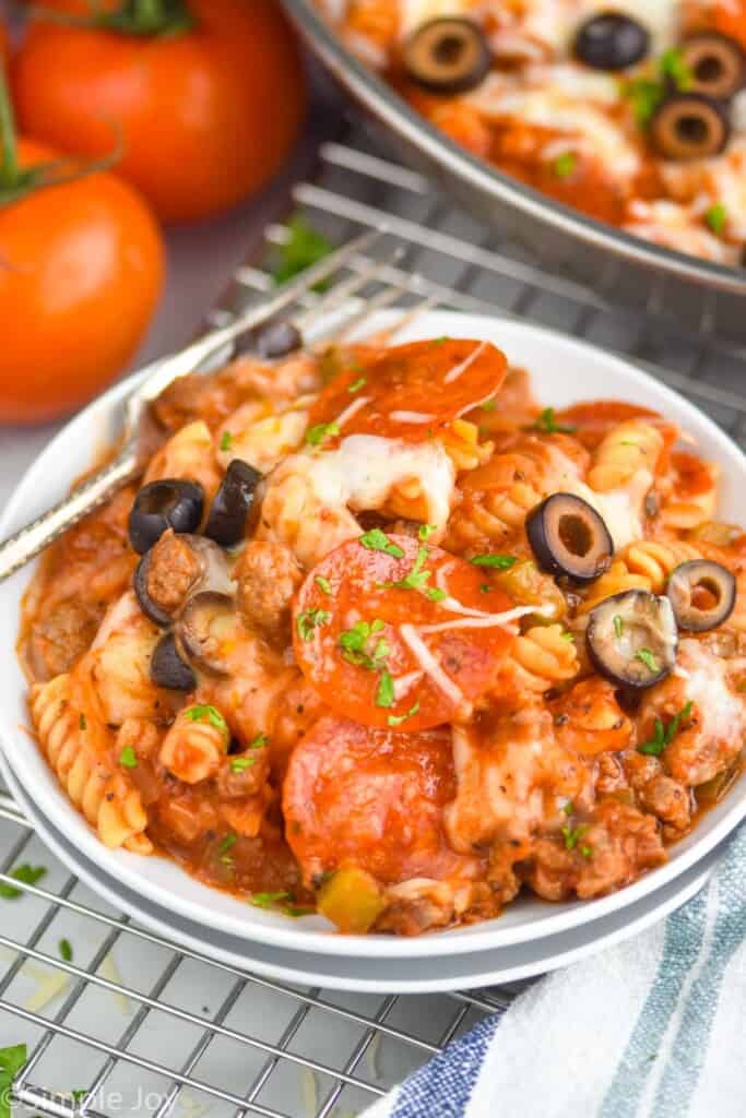 pizza pasta casserole dished upon two white dishes