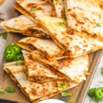 pinterest graphic of beef quesadillas on a platter