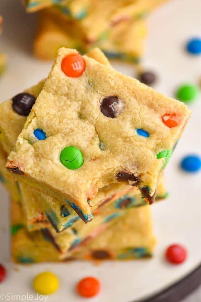 overhead view of a stack of cookie bars with m&ms in them
