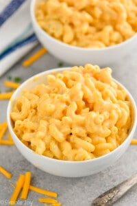 two small white bowls pilled high with macaroni and cheese recipe