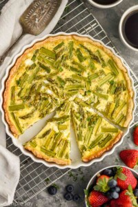 overhead picture of an asparagus quiche that has pieces cut out