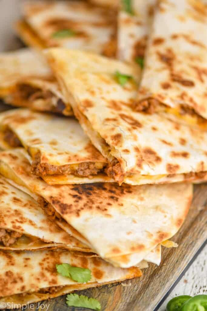 close up of a pile of beef quesadillas