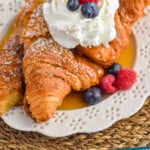 pinterest graphic of croissant French toast topped with whipped cream and berries