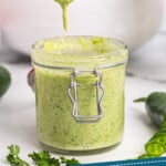 pinterest graphic of a small jar of jalapeno ranch dressing with a spoon dripping more over it