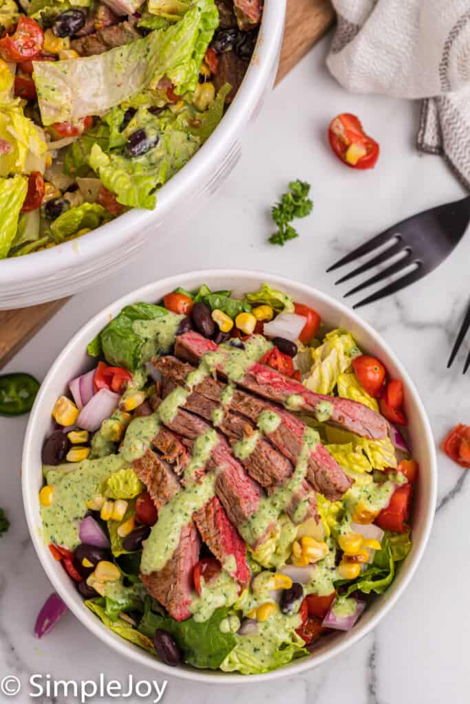 overhead of a southwestern steak salad with jalapeno ranch dressing