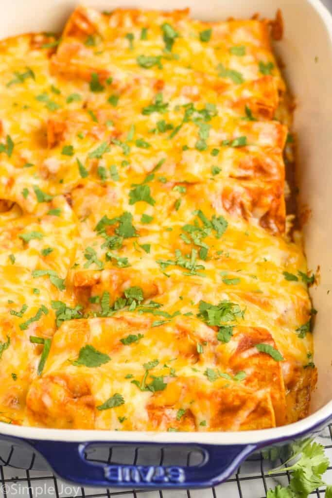 side view of a casserole dish full of baked enchiladas
