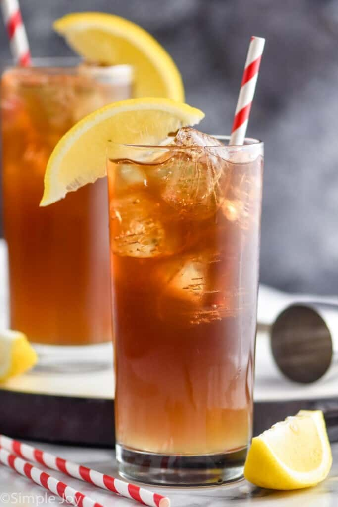 a high ball glass filled with ice and Long Island iced tea