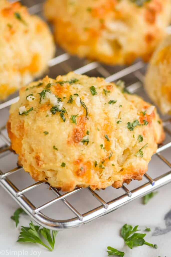 a red lobster cheddar bay biscuit on a cooling rack