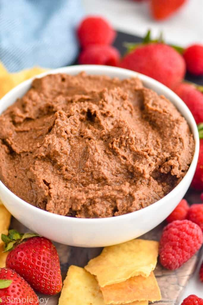 a white bowl filled with chocolate hummus