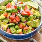 bowl full of cucumber tomato avocado salad